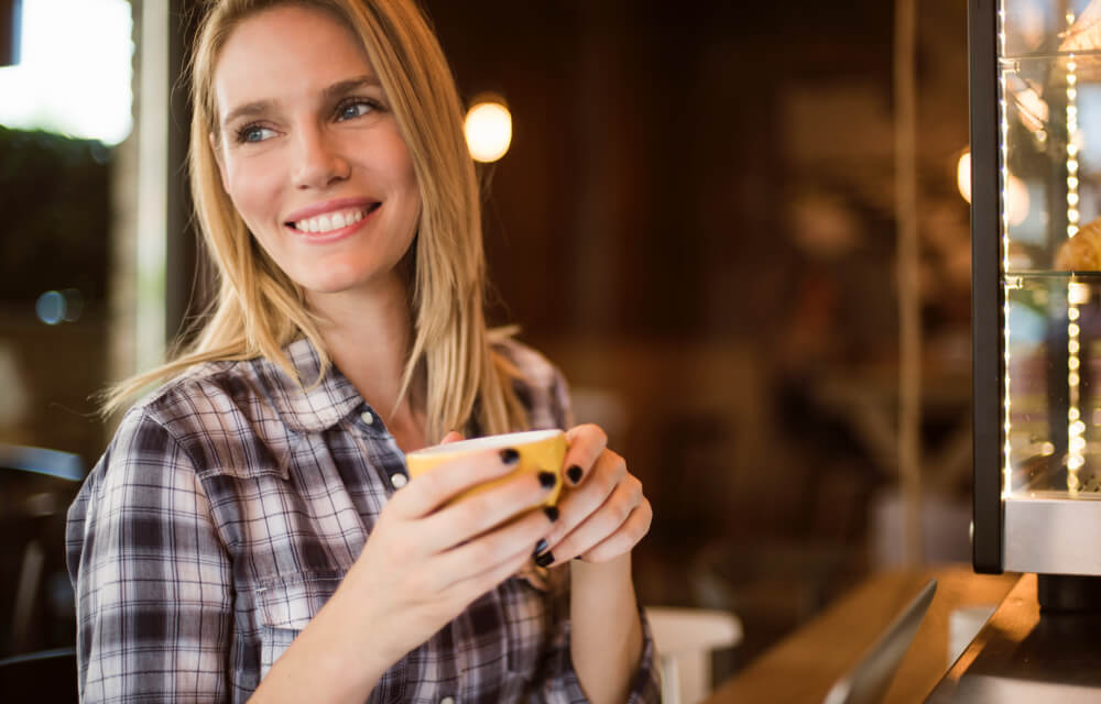 Woman with a nice smile holding a coffee mug